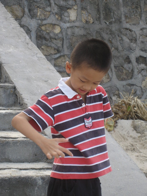 Xiao Huang, a gamer like his father, is a member of a chess club and gets instruction twice weekly.  He is rarey to be found without a deck of cards in his hands.  A candidate for Gamblers Anonymous in a few decades.