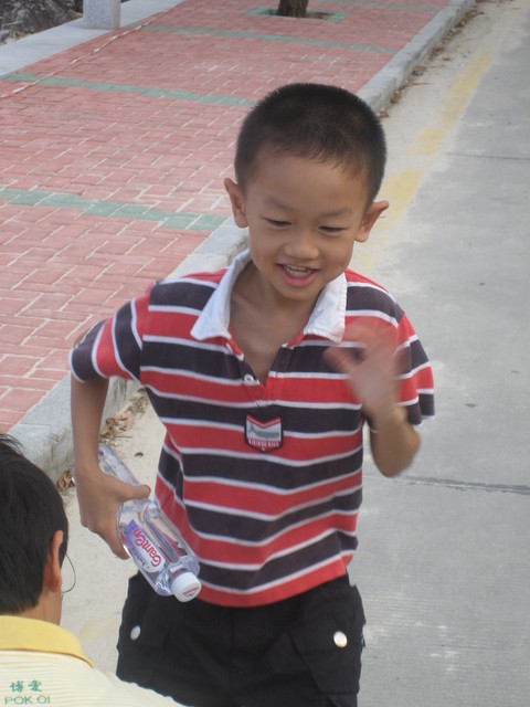 This is a kid who doesn't mind his photo being taken.  He used to by shy.